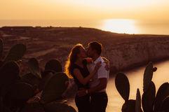 Couple kissing in the evening on the seaside Stock Photography