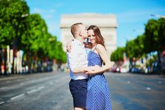 Couple kissing in front of Triumphal arch in Paris. France Royalty Free Stock Photo