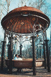 Couple kissing in gazebo Royalty Free Stock Image