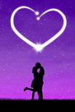 Couple kissing with heart Stock Photography
