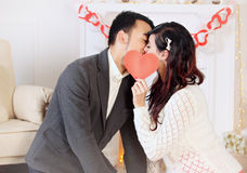 Couple kissing with heart Royalty Free Stock Image