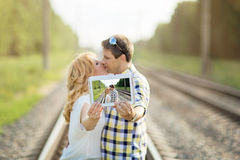 Couple kissing and holding their picture Royalty Free Stock Photos