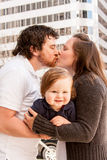 Couple Kissing, Holding Toddler Royalty Free Stock Photo