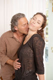Couple kissing at home. stock photography