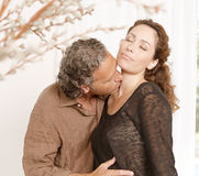 Couple kissing at home. Stock Image