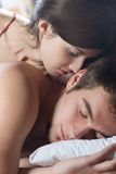 Couple kissing and hugging on the bed Stock Photography