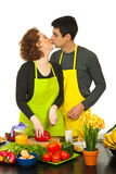 Couple kissing in kitchen Stock Image
