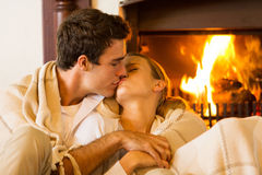 Couple kissing in living room Royalty Free Stock Images