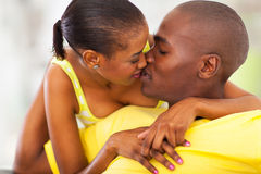 Couple kissing love. Young in love afro american couple kissing Royalty Free Stock Photos
