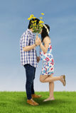 Couple kissing on the meadow Royalty Free Stock Photos