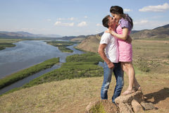 Couple kissing in mountains Royalty Free Stock Photos