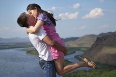 Couple kissing in mountains Stock Image