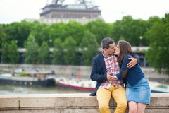 Couple kissing near the Eiffel tower Stock Photo