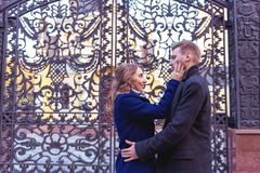 Couple kissing near the gate Royalty Free Stock Images