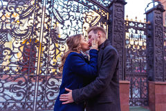 Couple kissing near the gate Royalty Free Stock Photography