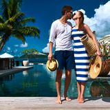 Couple kissing near poolside Stock Image