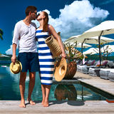 Couple kissing near poolside Royalty Free Stock Images