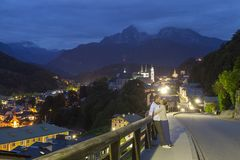 Couple kissing at night in Berchtesgaden. City, Germany Alps royalty free stock photography