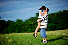 Couple kissing outdoor Stock Images