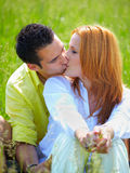 Couple kissing outdoor Royalty Free Stock Images