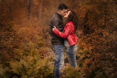 Couple kissing outdoor in the park Stock Photos