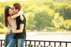 Couple kissing outside in worm sunny day Stock Image