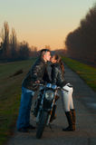 Couple kissing over the motorcycle Royalty Free Stock Image