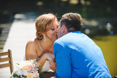 Couple Kissing Over Table. In sunlight Stock Image
