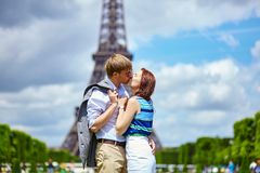 Couple kissing in Paris near the Eiffel tower Royalty Free Stock Photo