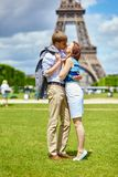 Couple kissing in Paris near the Eiffel tower Stock Photos