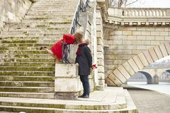 Couple kissing on a Parisian embankment Stock Photography