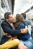 Couple kissing in Parisian metro Royalty Free Stock Images