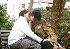Couple kissing - park Royalty Free Stock Image