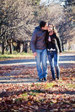 Couple kissing in a park Royalty Free Stock Photos