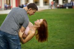 Couple kissing in the park Stock Image