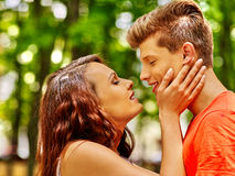 Couple kissing at park Royalty Free Stock Images