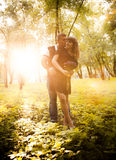 Couple kissing in park on sunset Royalty Free Stock Photography