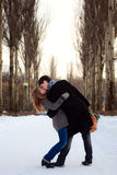 Couple kissing in the poplar alley Royalty Free Stock Photo
