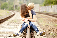 Couple kissing at railway. Urban photo. Stock Photos