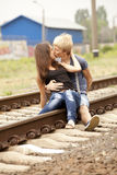 Couple kissing at railway. Urban photo. Royalty Free Stock Photos