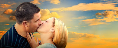 Couple kissing in romantic love scenery Stock Image