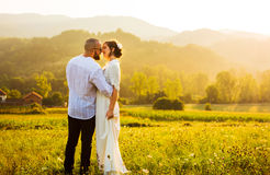 Couple kissing during a romantic sunset stock photo