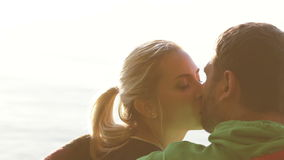 Couple kissing setting sun stock video footage