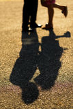 Couple Kissing Shadow. In sunset stock photo