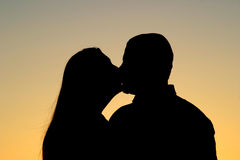 Couple Kissing Silhouette. Beautiful silhouette of a man and woman couple kissing at sunset. Very romantic Stock Images
