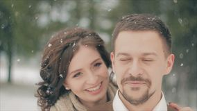 Couple Kissing on Snow Field on Winter Day. Slow Motion stock video footage