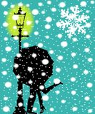 Lamp post In the Snow. A couple kissing during a snow storm by the light of a street lamppost Royalty Free Stock Photography