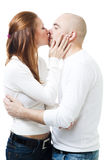 Couple kissing standing and embrace Stock Images