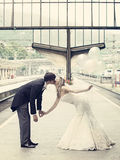 Couple Kissing Standing on the Train Waiting Platform Stock Photos