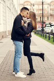 Couple kissing at street Stock Photography